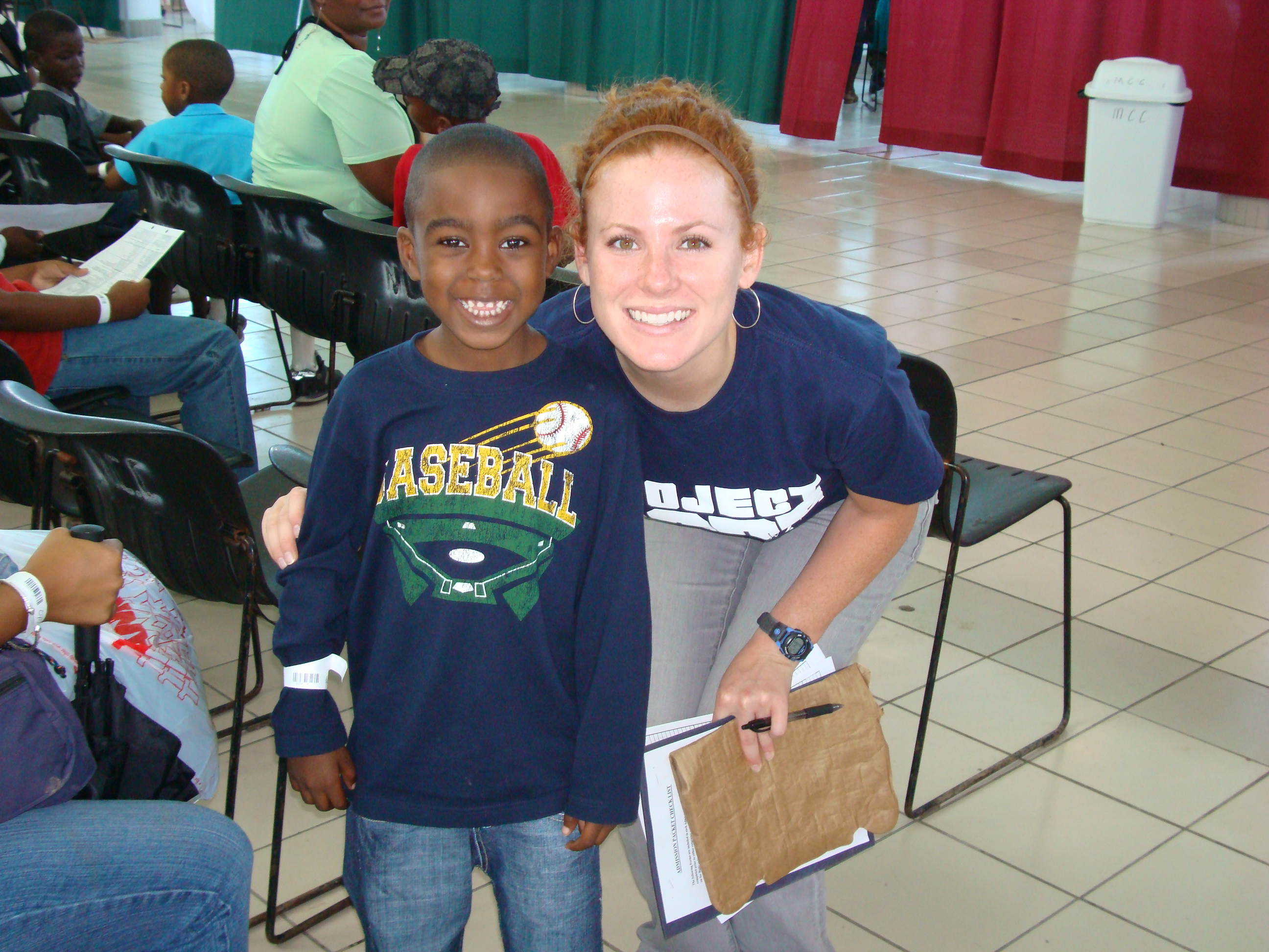 Six year old Desmalin with Project HOPE volunteer Kelly Magee.