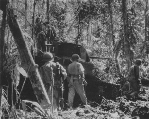 Marine light tank bogged down in jungle mud. So difficult was the terrain that the Marines had to give up using tanks.