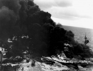 Flames on aft flight deck from fire that killed 28 Sailors and destroyed fifteen aircraft