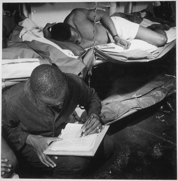 lossy-page1-591px--..._sailors_in_their_bunkroom_aboard_the_U.S.S._Ticonderoga_(CV-14)_on_eve_of_the_Battle_of_Manila,_PI._Thomas_L._Crens_-_NARA_-_520867