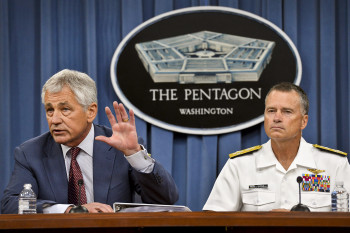 Secretary of Defense Chuck Hagel answers reporters' questions during a Pentagon press briefing on the recent Strategic Choices. Navy Adm. James A. Winnefeld Jr., right, vice chairman of the Joint Chiefs of Staff, joined Hagel for the briefing. (DOD photo by Glenn Fawcett)