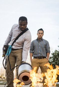 Seth Robertson and Viet Tran, electrical and computer engineering students, test their sound-blasting fire extinguisher prototype. Photo by Evan Cantwell.