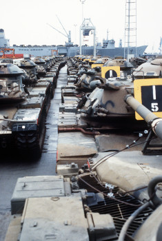 M-60 main battle tanks are lined up in the staging area at the Dundalk Marine Terminal after being offloaded from the vehicle cargo/rapid response ship USNS ANTARES (T-AKR-294). The tanks were used by the 32nd Separate Infantry Brigade (Mechanized), Wisconsin Army National Guard, during Exercise Reforger '86.