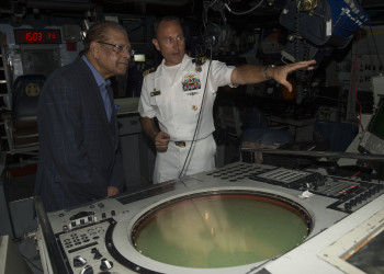 150203-N-QY759-196 PORT LOUIS, Mauritius (Feb. 3, 2015) Cmdr. Ken Anderson, commanding officer of the guided-missile frigate USS Simpson (FFG 56), gives a tour to Mauritius President Kailash Purryag. Purryag visits Simpson while it is in Port Louis, Mauritius, taking part in Exercise Cutlass Express 2015. This exercise, sponsored by U.S. Africa Command, is designed to improve regional cooperation, maritime domain awareness and information sharing practices to increase capabilities of East African and Indian Ocean nations to counter sea-based illicit activity. (U.S. Navy photo by Mass Communication Specialist 1st Class David R. Krigbaum/Released)