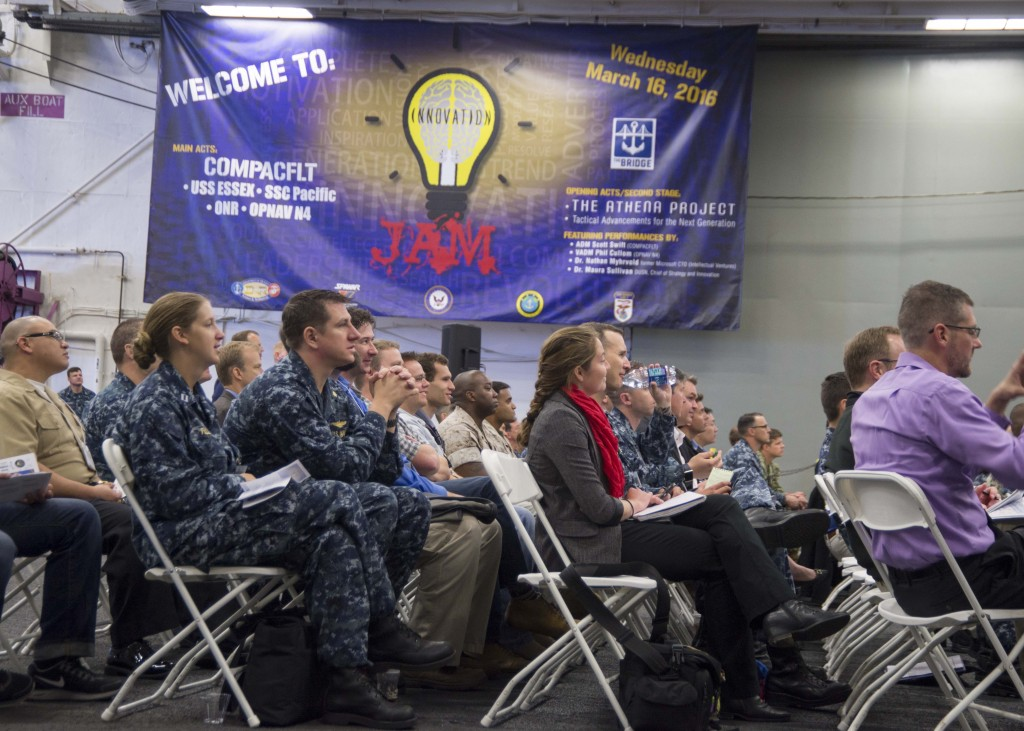 160316-N-BU440-025 SAN DIEGO (Mar. 16, 2016) Audience members listen to opening speeches at the Innovation Jam hosted aboard Wasp-class amphibious assault ship USS Essex (LHD 2). Commander, U.S. Pacific Fleet's (PACFLT) Bridge Program welcomes the Space and Naval Warfare Systems Center Pacific (SSC Pacific) Innovation Jam, sponsored by OPNAV N4 Fleet Readiness and Logistics and the Office of Naval Research. The Innovation Jam showcase pioneering concepts and rapid solutions to the fleet by SSC Pacific, the Athena Project, Tactical Advancements for the Next Generation and the Hatch. Solutions to Fleet-centric war fighting challenges are showcased by some of the bright and creative PACFLT Sailors. One of the bright ideas will be selected for initial funding, development, prototyping and possible transition to Fleet-wide implementation. (U.S. Navy Photo by Mass Communication Specialist 2nd Class Molly A. Sonnier/Released)