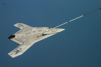 The Navy's unmanned X-47B receives fuel from an Omega K-707. U.S. Navy Photo.