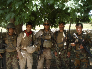 U.S. Marine Corps Capt. Tony Bates, then as 1st Lt. advisor team leader for the Afghan National Armed Forces, poses with Afghan forces he was advising in Sangin, Afghanistan. Bates was awarded the U.S. Navy and Marine Corps Commendation Medal with Valor device for combat action and Purple Heart, for his bravery in several actions while serving in that role. He was wounded in one patrol by an improvised explosive device (IED), which resulted in serious injury and his left leg being amputated below the knee. U.S. Marine Corps Photo/CAPT Tony Bates