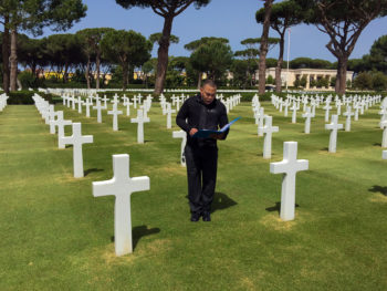 U.S. Marine Corps Captain. Tony Bates, deputy Executive Assistant to Vice Admiral James Foggo III, commander, U.S. 6th Fleet, reads the citation of Sgt. Sylvester Antolak, a medal of honor recipient for his actions in Operation Shingle at Sgt. Antolak's headstone in the Sicily-Rome American Cemetery., 10 May 2016. Personal. VADM James Foggo III photo