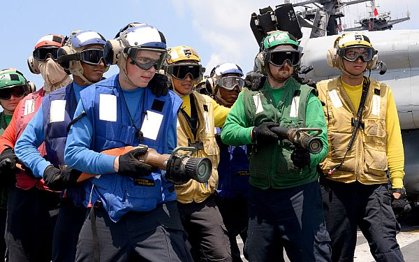 160503-N-GV721-161 GULF OF ADEN (May 3, 2016) Sailors assigned to Air department simulate fighting a fire during a fire drill on the flight deck aboard amphibious assault ship USS Boxer (LHD 4). Boxer is the flagship for the Boxer Amphibious Ready Group and, with the embarked 13th Marine Expeditionary Unit, is deployed in support of maritime security operations and theater security cooperation efforts in the U.S. 5th Fleet area of operations. (U.S. Navy photo by Mass Communication Specialist 2nd Class Brian Caracci/Released)