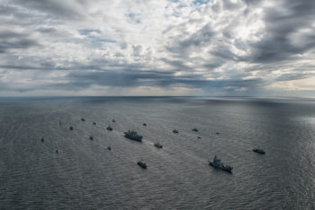 15 mine counter measure ships from 13 nations (Belgium, Denmark, Estonia, Finland, France, Germany, Latvia, Lithuania, Netherlands, Norway, Sweden, United Kingdom, and the United States.) maneuvered in close formation near command ship USS Mount Whitney (LCC 20) for a surface ship Photo Exercise