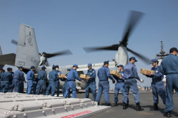160419-N-AE545-609 KUMAMOTO, Japan (April 19, 2016) Members of the Japan Maritime Self-Defense Force load supplies onto an MV-22B Osprey aircraft from Marine Medium Tilitrotor Squadron (VMM) 265 attached to the 31st Marine Expeditionary Unit in support of the Government of Japan's relief efforts following earthquakes near Kumamoto. The long-standing alliance between Japan and the U.S. allows U.S. military forces in Japan to provide rapid, integrated support to the Japan Self-Defense Force and civil relief efforts