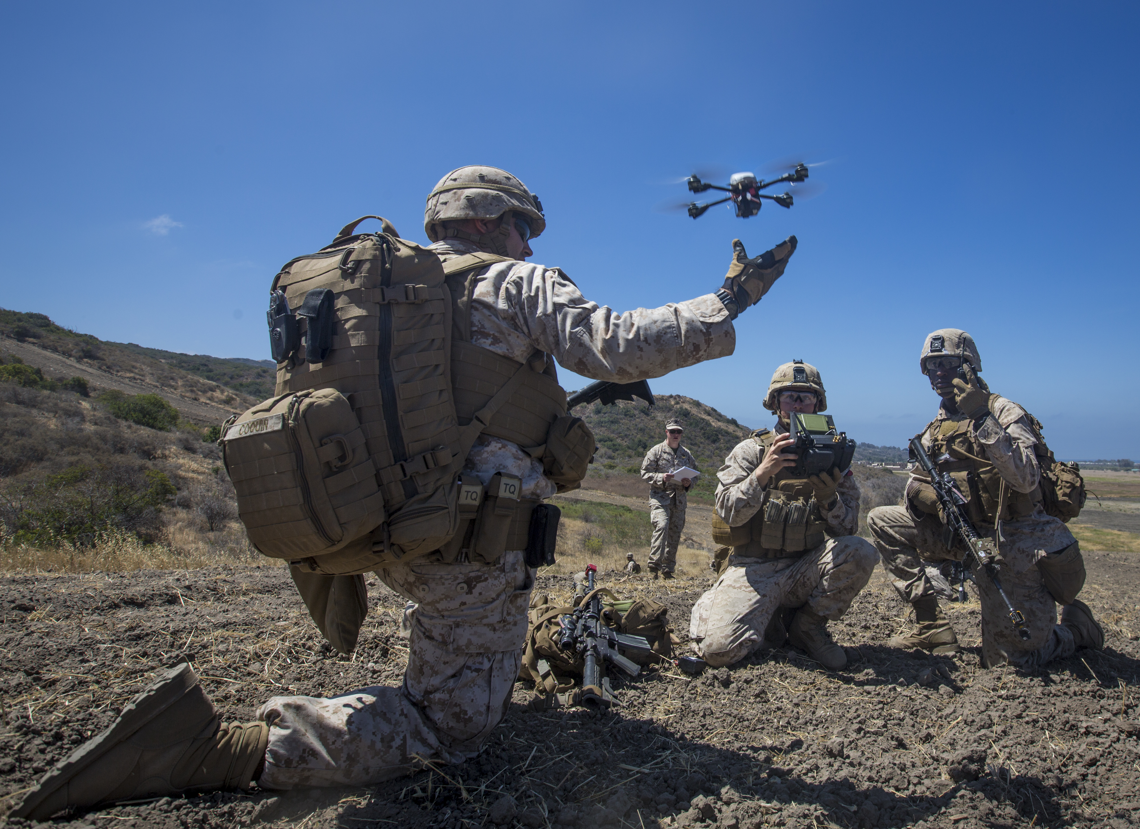 Marine Lance Cpl. Benjamin Cartwright launches the Instant Eye MK-2 Gen 3 unmanned aerial system during an exercise for Marine Corps Warfighting Laboratory's Marine Air-Ground Task Force Integrated Experiment  on Camp Pendleton, Calif., July 9, 2016