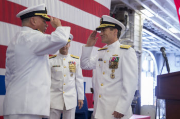 Rear Adm. John B. Nowell, Commander, Expeditionary Strike Group (ESG) 7, turns over command to Rear Adm. Marc H. Dalton aboard amphibious assault ship USS Bonhomme Richard (LHD-6) during a change of command ceremony