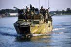 110712-N-CD297-143 NORFOLK (July 12, 2011) Sailors assigned to Riverine Group (RIVGRU) 2 participate in pre-deployment exercises in a riverine command boat powered by an alternative fuel blend of 50 percent algae-based and 50 percent NATO F-76 fuels. The alternative fuel mix supports the secretary of the Navy's efforts to reduce total energy consumption on naval ships. RIVGRU-2 is stationed at Joint Expeditionary Base Little Creek-Fort Story. (U.S. Navy photo by Mass Communication Specialist 1st Class Andre N. McIntyre/Released)