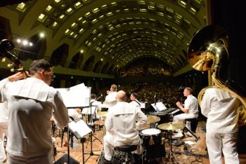 The U. S. Naval Forces Europe Band plays to a full house Sept. 9, 2015 to commemorate the anniversary of the liberation of Salerno, Italy (U.S. Navy photo by Chief Mass Communication Specialist (select) Brian P. Biller)
