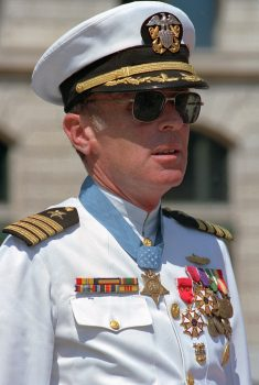 Captain Thomas G. Kelley stands at attention during his retirement ceremony at the United States Navy Memorial, 31 August 1990