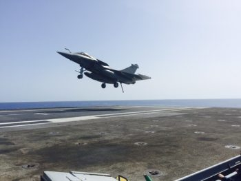 French Rafale fighter recovers aboard aircraft carrier Charles de Gaulle (R91) dropping ordnance on Da'esh targets in Syria. (Personal photo courtesy of Vice Adm. James Foggo III)