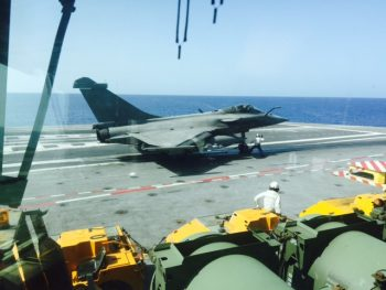 A Rafale fighter prepares to launch off the deck of the aircraft carrier FS Charles de Gaulle (R 91) on a strike mission against Da'esh. (Personal photo courtesy of Vice Adm. James Foggo III)