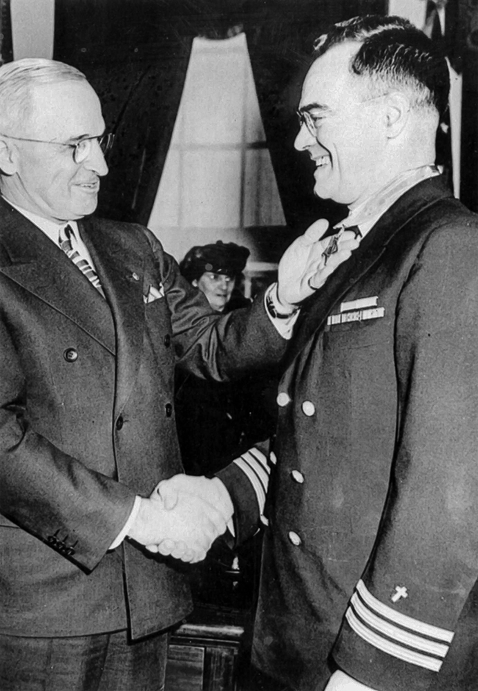 Chaplain O'Callahan is awarded the Medal of Honor by President Harry Truman at the White House, 23 January 1946