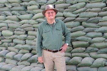 Jonathan Addleton at Kandahar Air Field in early 2013, standing in front of a wall of sand bags. (Photo by Staff Sergeant Ashley Bell, 102nd Mobile Public Affairs Detachment, Mississippi National Guard)