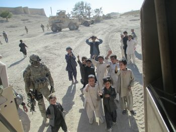 Afghan children surrounding an MRAP as it prepares to depart Alexander's Castle in Qalat, Zabul (Photo by Jonathan Addleton)